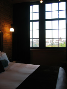 Guest rooms have original art and deluxe bathrooms; some come with a city view