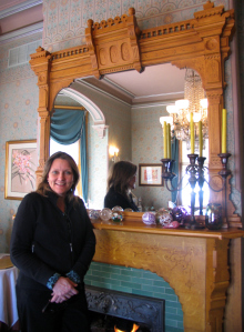 Laurel Parrott in the breakfast room; the mirror reflects an original chandelier