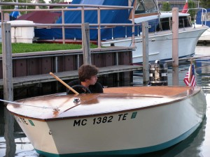 Graham hand-built this motorboat while he was in high school; he also constructed a 17'wood/fiberglass kayak