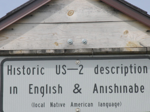 Roadside marker tells the history of US-2 in two languages