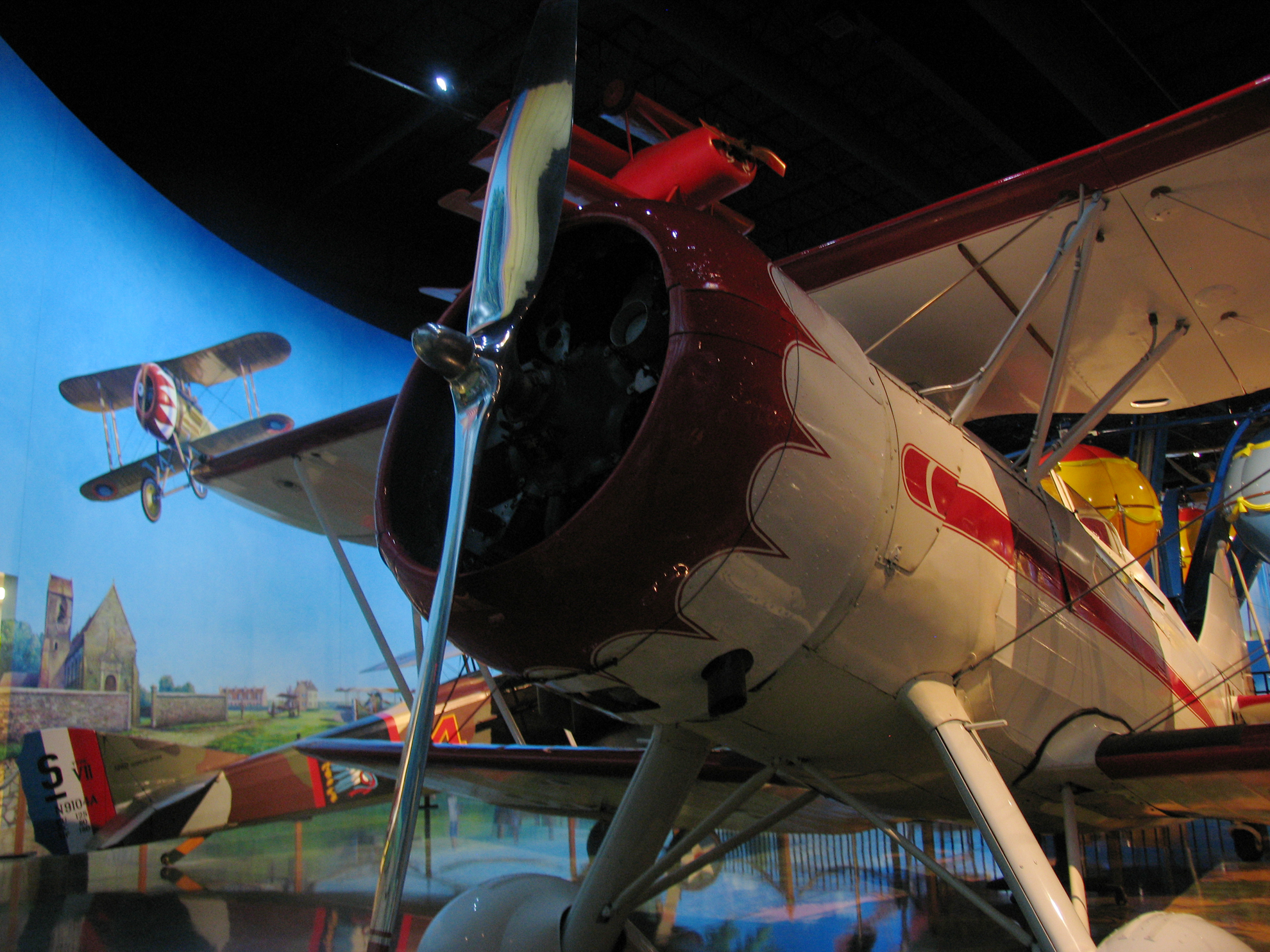 One of only six WACO VPF planes ever built were used by the Guatemalan Air Force; it's pictured in the mural behind it