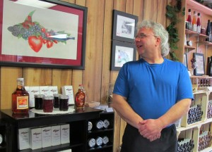 Winery owner John Lucas admires the Garden Bay logo art by his daughter Emily