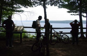 Mountain bikers from Germany pause at an overlook