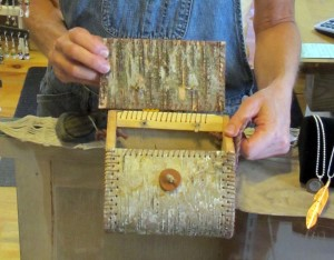 Jill shows a statement purse of bark with a wooden button closure