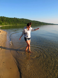 Paige tests the water at Sand Point beach just east of Munising