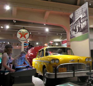 The Driving America exhibit includes a variety of vehicles and Texaco service station