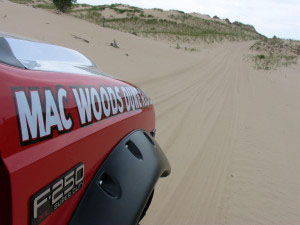 Fords still conquer the dunes; today's Dune Scooters are adapted from F-150 trucks