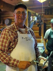 Cook Pete concocts the special sausage mix---delish