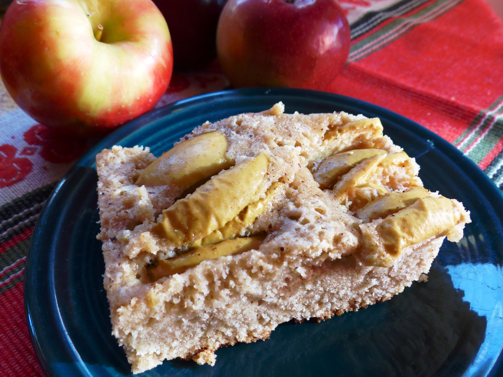 A moist cake with apple slices baked on top