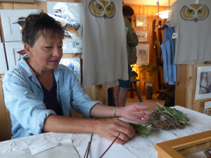 Barb Erickson works on a  twig creation in her studio/gallery on the Lake Superior shore