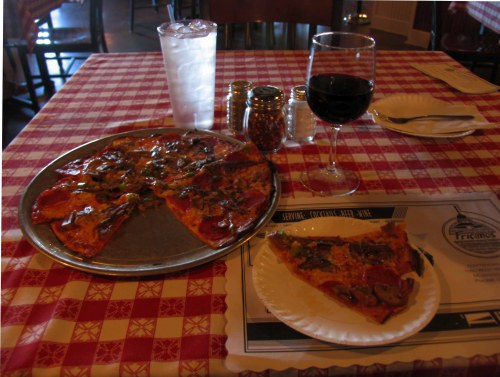 Fricano's Pizza, one size, served on a paper plate. Simply delis.