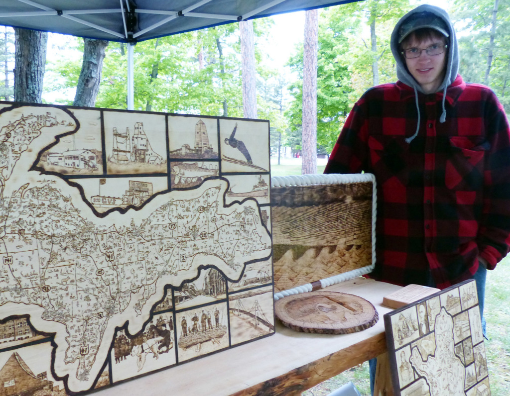 Aaren Joki and some of his creations. Yes, it was that cold at Midsummer in Marquette .